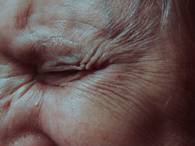 Wrinkles on someone's face.