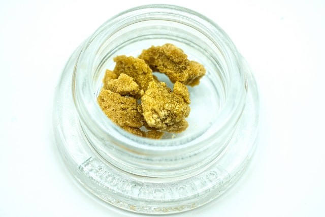 Cannabis extract in a glass container.