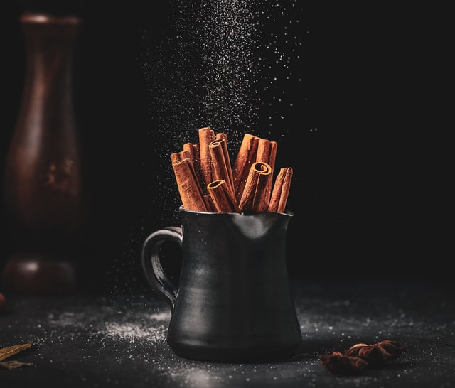 A cup with cinnamon in it.