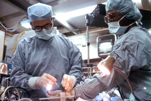 Surgeons in a surgery room.