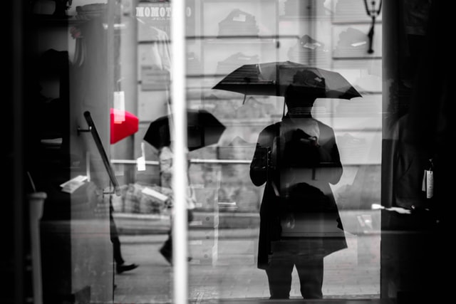Woman with an umbrella.