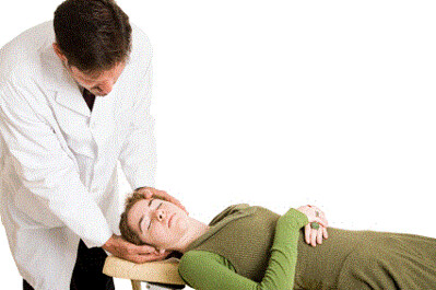 Chiropractor giving a woman an adjustment.