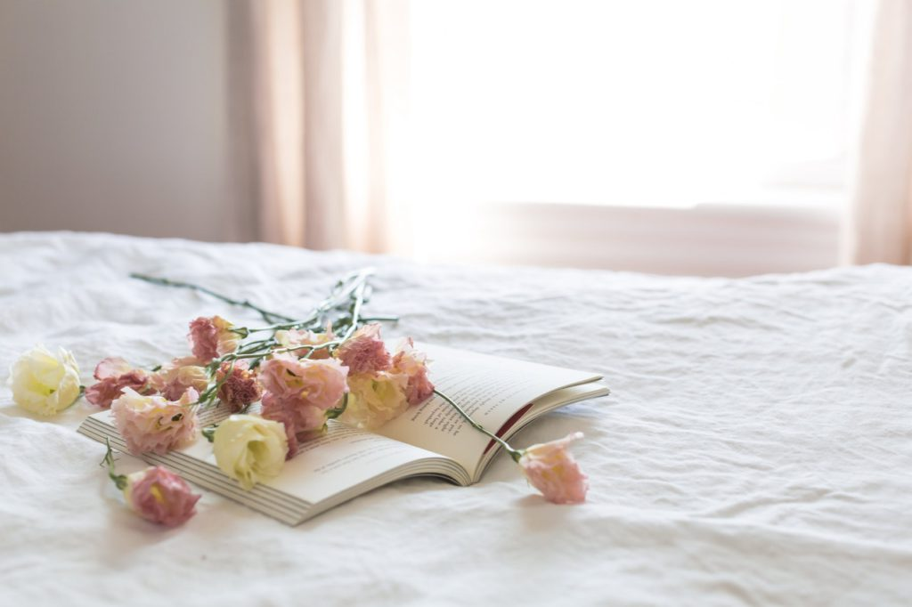 Book laying on bed.