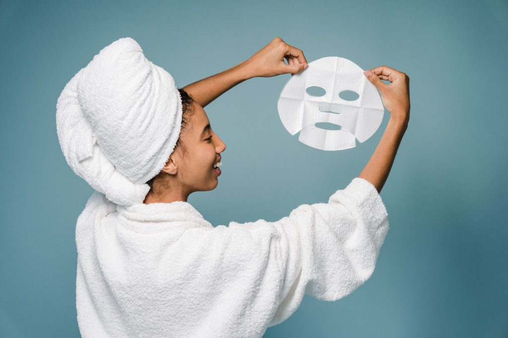 Woman holding a skin facial mask.