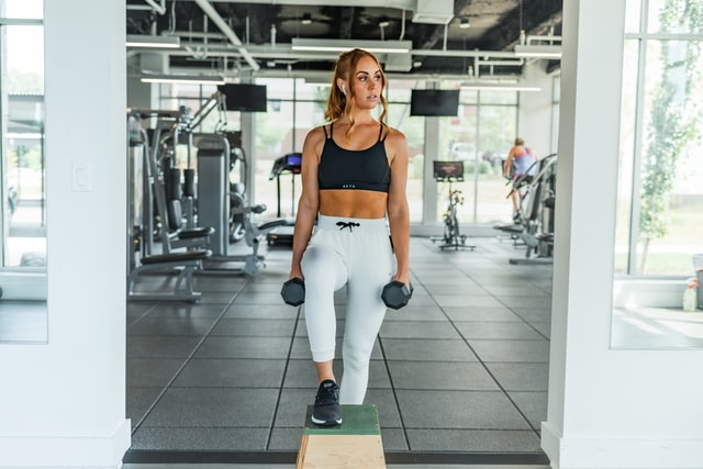 Woman holding weights.