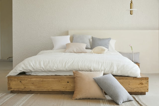 A bed with pillows on it.