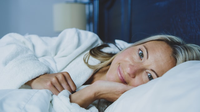 Woman laying in bed.