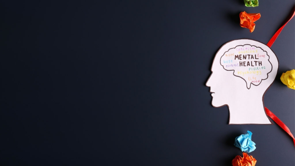 persons head with mental health written inside of head