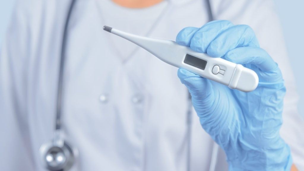 provider holding a thermometer