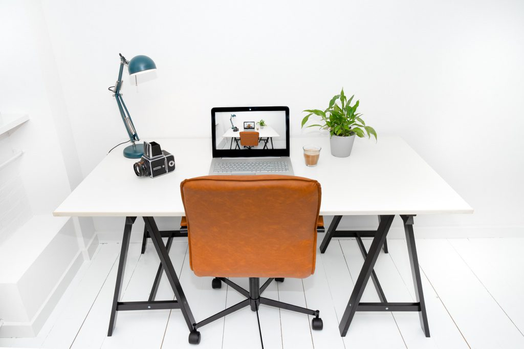 Workspace with laptop on desk.