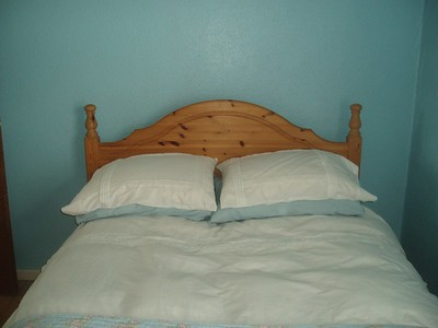 A bed with pillows and sheets on it.