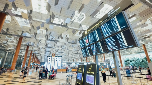 Airport with large monitors for flight information.