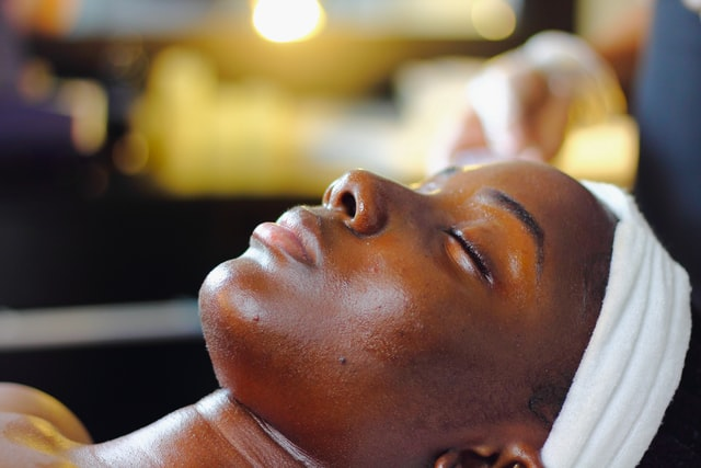 A woman treating her skin.